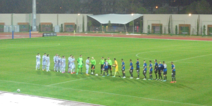 The teams line-up before shaking hands.
