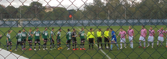 The teams prepare to shake hands prior to Ried's 1:0 win
