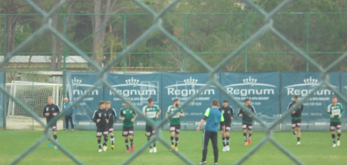 Members of the starting XI warm up before the Cracovia clash.