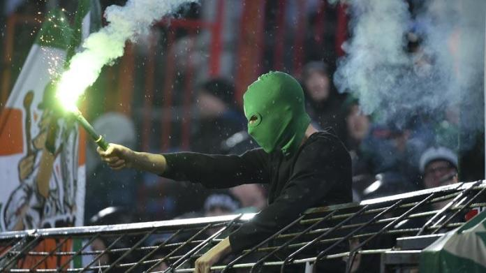 A Rapid Vienna fan holds a flair at the away game vs. Admira Wacker (photo courtesy of Laola1.at)