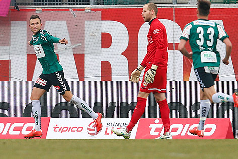 Thomalla (left) celebrates following his 2nd goal against Red Bull Salzburg. (Picture courtest of GEPA/Felix Roittner)