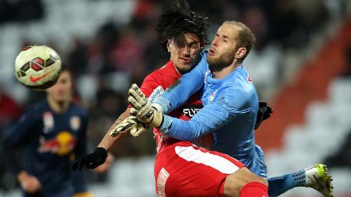 Toni Vastic (left) clashes with Salzburg goalkeeper Péter Gulácsi (right). The Admira striker had to be stretchered off, but earned his side a 2nd half penalty- Round 23 (picture courtesy of laola1)