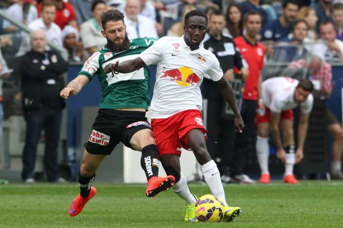 Naby Keita is challenged by Ried's Oliver Kragl during the Bulls 2:1 victory (picture courtesy of GEPA)