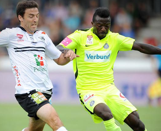 Kayode (left) battles against Wolfsberg's Joachim Standfest during his side's 2:0 victory. (Picture courtesy of FK Austria Wien)